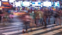 New York City Times Square at night intersection crowd walking time-lapse Stock Footage