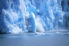 View of a glacial ice avalanche, Argentina Stock Photos
