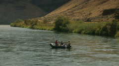 Rafters drifting in river Stock Footage