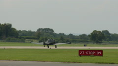 WW2 American fighter plane taking off Stock Footage