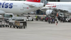 Loading luggage in a plane before take-off Stock Footage