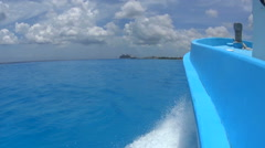 Side view from boat in deep blue waters Stock Footage