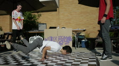 Break dancer at a College block party Stock Footage