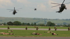 Military helicopters landing during field exercises Stock Footage