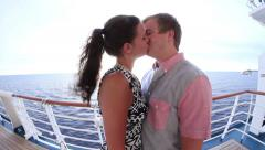 Attractive couple kissing on cruise ship Stock Footage