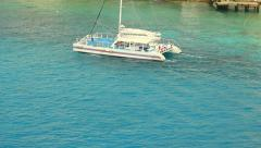 Catamaran going left to right in turquoise waters Stock Footage