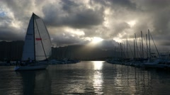 Sailboat at sunset, kaneohe bay, oahu, hawaii. Stock Footage
