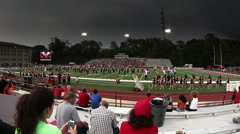 Storm clouds over college football game - stadium Stock Footage