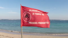 Warning Sign on the beach in Bali do not swim Stock Footage