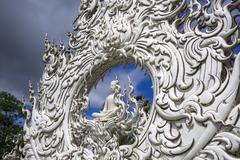Wat Rong Khun, Architectural Details. Sitting Buddha. - stock photo