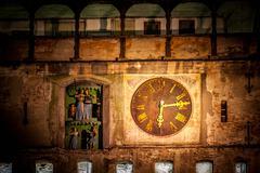 old clock in sighisoara medieval city, photo taken night time - stock photo