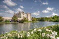Ancient castle in leeds kent with large lake acting as moat on a sunny day Stock Photos