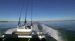 Gone fishing! Motor boat view looking back. Rangitoto Channel, New Zealand. - stock footage