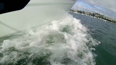 Motor boat prow cutting through water fish-eye wide angle. Stock Footage