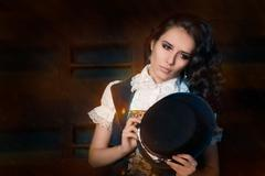 Steampunk Girl with Top Hat and Aviator Glasses - stock photo
