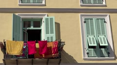 Old house and hanging clothes in Menton close up Stock Footage