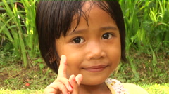Shy Little Girl in Bali Indonesia Stock Footage
