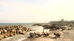 Tsunami Damage and Nuclear Power Plant in the background near Fukushima Stock Footage