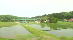 View of the Country Side in Japan from the train - stock footage