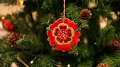 Christmas tree decoration, Tudor red rose, English symbol, pine cones, lights Stock Footage