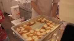 Japanese food Inarizushi, stuffed tofu skin sushi being prepared Stock Footage
