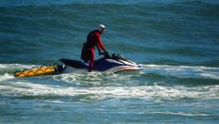 Lifeguard on Jet Ski in Malibu, California - stock footage