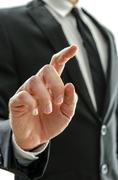 Businessman's hand with pointed finger Stock Photos