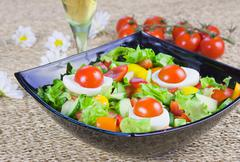 Stock Photo of lettuce from vegetables with fresh greenery  in a decorative dish