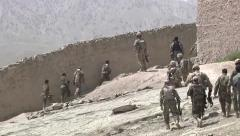 US Soldiers train afghan national army - walking soldiers Stock Footage