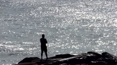 A man contemplating the great sea Stock Footage