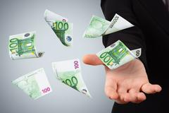 Stock Photo of euro banknotes on young business woman