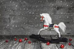 Old wooden horse - shabby chic christmas decoration - background for a greeti Stock Photos