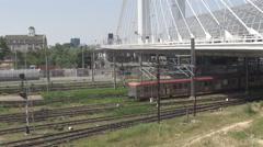 Car traffic on suspension bridge over train railway train move slow, destination Arkistovideo