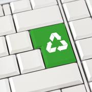 Stock Photo of green recycle icon on a computer keyboard