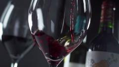 Slow motion red wine being poured into a glass - stock footage