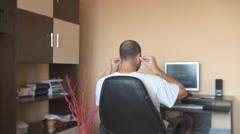 Man watching movie home at desktop computer, headphones on enjoy favorite serial - stock footage