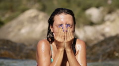 Girl washes his face Stock Footage