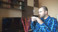 Handsome white boy home smelling new scented candles bought, delightful time   Stock Footage