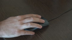 Computer mouse in hand, man using on desk mouse, moving and clicking, close up Stock Footage