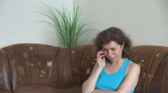 Adult woman home, relaxing on couch, mobile phone talk, enjoy conversation smile Stock Footage