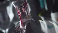 Slow motion wine is poured decanter Stock Footage
