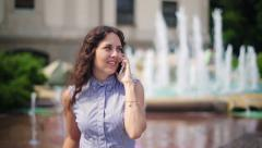 Beautiful woman chatting on the cellphone and smiling Stock Footage