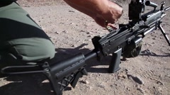 Loading  of belt fed machine gun - M249 SAW Stock Footage