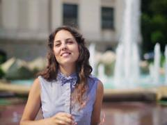 Woman smiling to the camera and taking off sunglasses Stock Footage