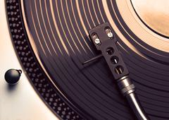 top view of old fashioned turntable playing a track - stock photo