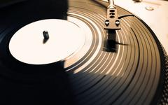 old fashioned turntable playing a track - stock photo