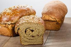 loaves of fresh whole wheat bread - stock photo