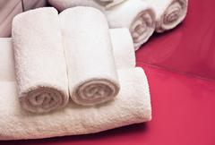 Rolled white towels in bathroom Stock Photos
