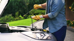 Man checking oil in his car  Stock Footage