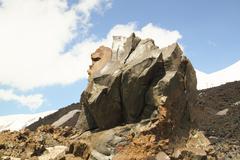 Huge stone of volcanic origin on the mountain top Stock Photos